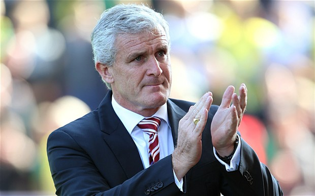 Stoke City manager Mark Hughes prior to kick-off during the Barclays Premier League match at the Britannia Stadium, Stoke. PRESS ASSOCIATION Photo. Picture date: Sunday September 29, 2013. See PA story SOCCER Villa. Photo credit should read: Lynne Cameron/PA Wire. RESTRICTIONS: Editorial use only. Maximum 45 images during a match. No video emulation or promotion as 'live'. No use in games, competitions, merchandise, betting or single club/player servies. No use with unofficial audio, video, data, fixtures or club/league logos.